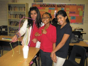 Alanis Beauchamp, Autumn Lyons and Hayris Panchi, fifth graders at Woodland Elementary School in Sandy Springs, build a tower out of shaving cream during 'Brain Power Day.'