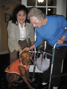 Doris Beardsley, left, and Amberley, visiting Sarah Baker at Plantation South Assisted Living in Dunwoody.