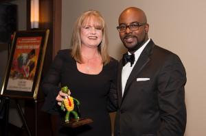 Tisha Rosemond, owner of Nothing Bundt Cakes, left, with Sandy Springs/Perimeter Chamber of Commerce Chairman Cory Jackson.