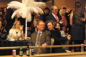 Frank Maier, center, and wife Blanchette, right, enjoy the anniversary festivities at the Buckhead Theatre on March 1.