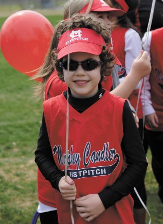 Rachel Axelson stands with her balloon during the opening ceremonies of Murphey Candler Girls Softball on March 9.