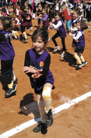 Gracie Bomar, a member of the girls' rookie softball league Tigers, shows off her moves during opening ceremonies for Sandy Springs Youth Sports at Morgan Falls Overlook Park on March 9.