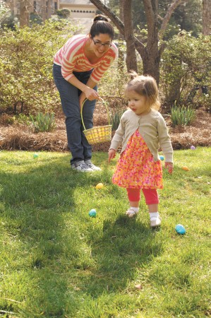 Party hostess Nicole Johnson helps daughter Emma with the eggs.