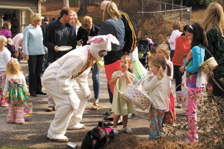 Ray and Nicole Johnson, residents on Woodsong Court in Dunwoody, held the neighborhood's annual Easter party at their home on March 30.