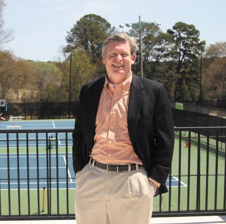 Chastain Park Civic Association President Jim King stands in front of the park's tennis center.