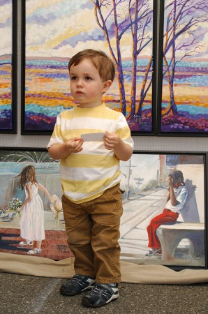 Jonah Wood, 2, checks out the paintings of Jamie Kiro of Cumming Georgia.