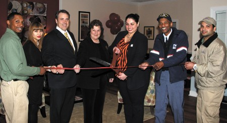 Sierra Place Apartments recently joined the Sandy Springs/Perimeter Chamber of Commerce, and celebrated the remodeling of their clubhouse with a ribbon cutting.  Joining the event were Sandy Springs Councilwoman Karen Meinzen-McEnerny, center left, Community Manager Evelyn Gomez, right, with scissors, as well as staff, Chamber ambassadors and friends.  Sierra Place is located  inside I-285 on Northwood Drive, just north of the Prado.