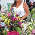 Spring colors surround Paula Guilbeau at the Dunwoody Green Market