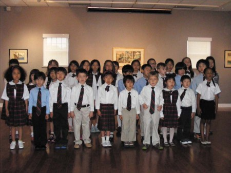 """Students from the Seigakuin Atlanta International School sing for Oglethorpe Museum patrons during the opening of the exhibition, """"Jiki to Hanga: Japanese Porcelain and Prints."""""""