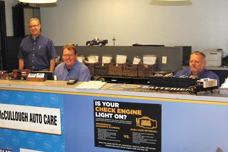 From left, three brothers, Eric, Rod and Brian McCullough, run the car shop McCullough AutoCare, continuing their father's legacy.
