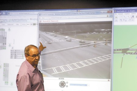 Sandy Springs Traffic Engineer Bill Andrews shows an image of an intersection displayed in the city's Traffic Management Center.