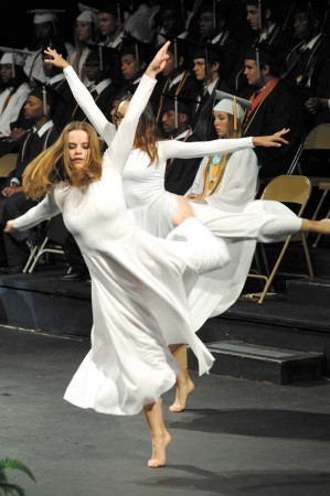 """A member of the senior class dance ensemble performs to the class's song """"Reach."""" Right, the many faces in the class of 2013."""
