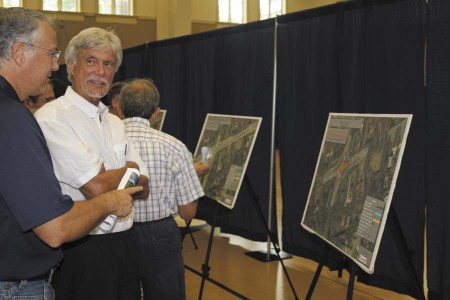Carlos Bouffier, left, and Henry Staats discuss turn lanes proposed for Mount Vernon and Vermack roads.