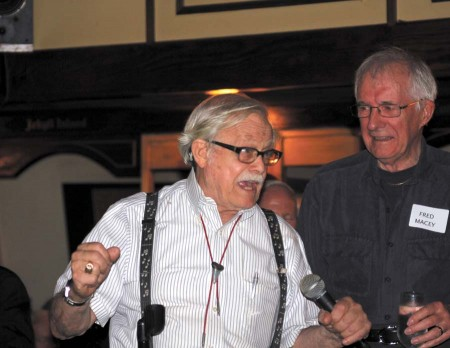 Dante Stephensen holds court during a June 6 farewell party at his long-time Buckhead restaurant, Dante's Down the Hatch.