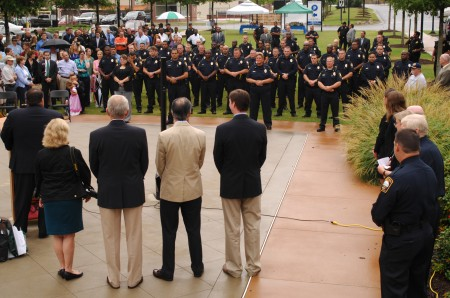 Brookhaven City Council members look out at the new Brookhaven police officers as Mayor J. Max Davis speaks at a ceremony launching the Brookhaven Police Department July 31.