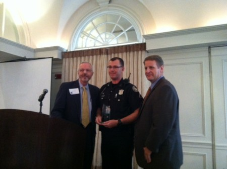 BBA board member Mark Shaver, left, presents Atlanta Police Investigator William J. Lyons, center, with a Public Safety Award along with BBA President Brian Daughdrill, right.