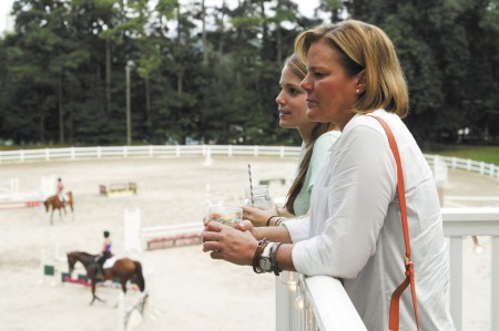 Cathy Dugan, front, along with her daughter Breanna Rotell, check out the Chastain Horse Park during a Bluegrass &  Bar-B-Q  summer social on Aug. 1. The two toured the newly renovated clubhouse, while they plan Breanna's October wedding at the facility.