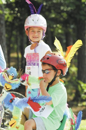 """Noelle Chatigny, 6, behind brother Andrew, 4, show off their """"Angry Birds"""" bikes during the Wheel-A-Palooza and Pedal Parade at Brook Run Park on Aug. 3 in Dunwoody.  The park celebrated the opening of Phase 1  of its new trail."""