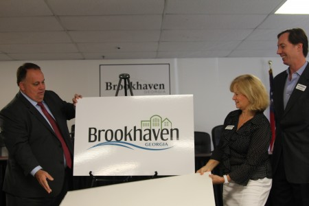 Left to right: Brookhaven Mayor J. Max Davis and City Council members Rebecca Chase Williams and Bates Mattison reveal the city's new logo at a press conference at Brookhaven Municipal Court Aug. 29.