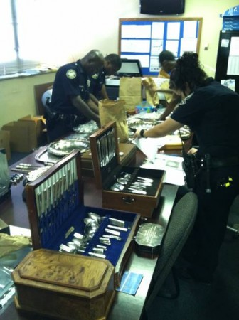 Atlanta Police sort through the loot recovered in the course of investigating reports of silver stolen from Buckhead homes.