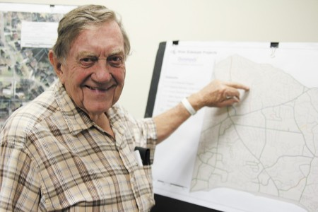 Charles Brake points out his home on the sidewalk projects' map during a public meeting Sept. 12. A new sidewalk is planned for his street, Mount Vernon Way.