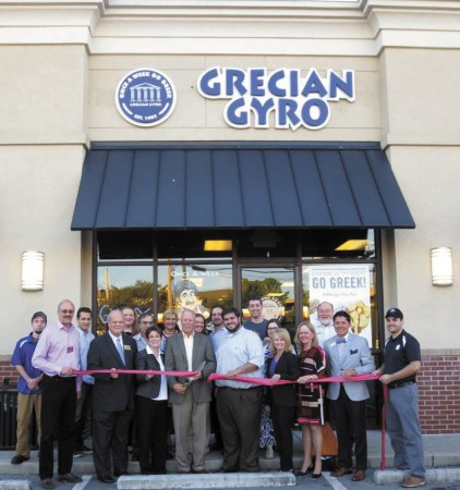 On Oct. 11, the Dunwoody Chamber of Commerce hosted ribbon cutting ceremonies for Grecian Gyro, located at the Shoppes of Georgetown in Dunwoody. Mayor Mike Davis, along with members of Dunwoody City Council and the Chamber of Commerce, were on hand to celebrate with owner George Koulouris and employees. The restaurant  specializes in gyro wrap sandwiches, salads and sides, incorporating Greek ingredients and traditions.
