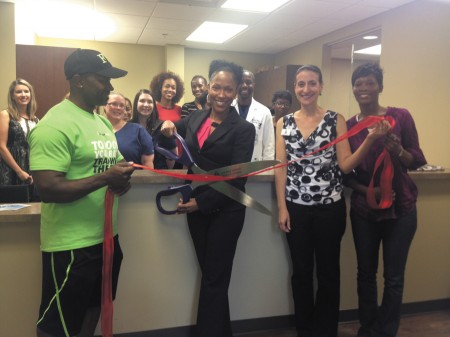 Dr. Measha Dancy, center, holding the scissors, is surrounded by associates, clients and friends, as she marks the opening of Comprehensive Internal Medicine, located at 960 Johnson Ferry Road, Suite 543, in Atlanta. The practice opened a new location next to Northside Hospital after 10 years serving the Alpharetta and Johns Creek communities.