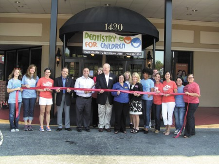 The Dunwoody Chamber of Commerce and Dunwoody City Council members held a ribbon cutting on Sept. 7 to note the grand opening of Dentistry for Children and Family Orthodontics, located at 1420 Dunwoody Village Parkway. From left, employees Natalie Copeland, Natalie New, Allison Howard, chamber board member Dr. Jeffrey Priluck, employee Dr. Ezat Mulki, chamber member Tyra Guthrie, City Council members Terry Nall and Lynn Deutch, chamber member Jan Slimming, Chamber Executive Director Beth Summers, employee Rachel Brennan, chamber member Alan Slimming, and employees Bevin Rogers, Edie Warren, Vanessa Bercian and Sia Grable.