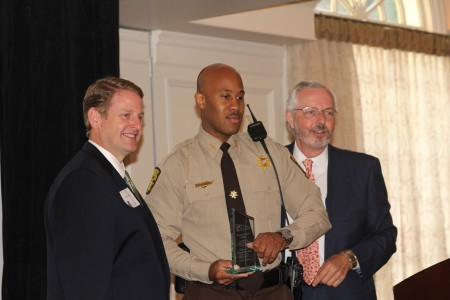 BBA President Brian Daughdrill, left, presents an award to Officer William Whitaker of the Fulton County Sheriff's Department, center, along with BBA Vice President of Public Safety Mark Shaver, right.