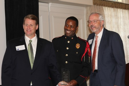 BBA President Brian Daughdrill, left, presents an award to Atlanta Firefighter Andre Rogers, center, along with BBA Vice President of Public Safety Mark Shaver, right.