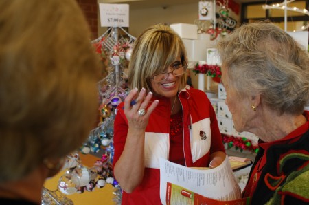For more than 40 years, Hollie Bell, center,   has made holiday decorations. She had members of three generations of her family working with her during the Elegant Elf market.