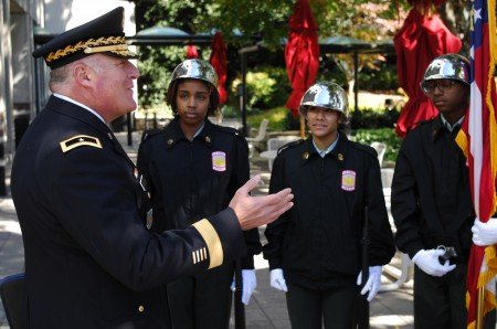 Brig. Gen. John King, Georgia National Guard, speaks with the North Springs Charter High School JROTC Honor Guard during a Nov. 11 Veterans Day ceremony in Sandy Springs.