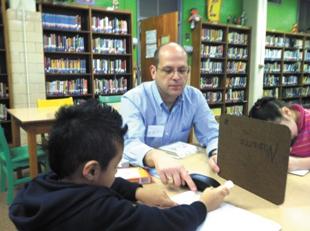 John Freeland, pastor at Skyland United Methodist Church in Brookhaven, tutors youngsters at Ashford Park Elementary in reading.