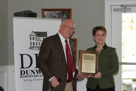 Heyward Wescott, left, presents Dunwoody Homeowners Association  Community Service Award to former Dunwoody City Councilwoman Adrian Bonser during the DHA's annual meeting Jan. 12, 2014 at Kingsley Racquet & Swim Club. Photo by Joe Earle.