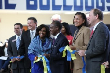 From left: State Rep. Mike Jacobs, R-Brookhaven, Chamblee Mayor Eric Clarkson, DeKalb County Board of Education Member Karen Carter, DeKalb County Schools Superintendent Michael Thurmond, Chamblee Charter High School Principal Rochelle Lowery, and DeKalb County Board of Education Member Marshall Orson cut a ribbon to mark the opening of the new school building for Chamblee Charter High School Jan. 22