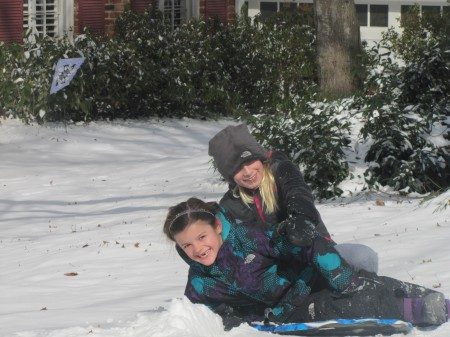 Ella Ryan. 7. and Kate Rosen, 10, of Dunwoody enjoy the wintry weather during a snow day off from school Jan. 29. Photo by Robin Isaf