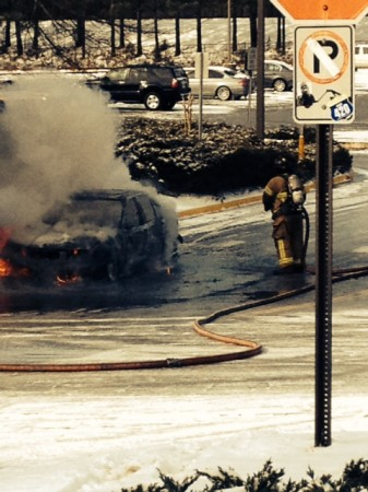 A car caught fire at the Brookhaven MARTA station after the storm. Photo by Deborah Davis