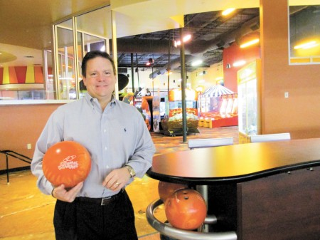 Chris Albano, co-owner of the Stars and Strikes bowling venue in Sandy Springs, says the facility also offers laser tag, video games, a full bar and restaurant, and live entertainment.