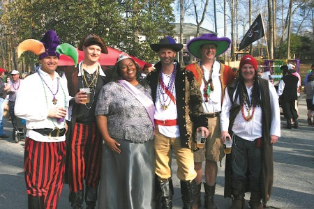 Erika Allen, center, was crowned this year's parade queen at Krewe du Forest's annual event. Krewe board members surrounding the queen are, from left, Greg Bishop, Mark Stovin, David Moffett, Fleet Medford and John Griner.