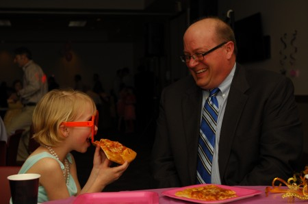 David Fontaine and daughter Emma, who's 8, share a pizza during the Father-Daughter Dance at Marcus Jewish Community Center of Atlanta on March 23.