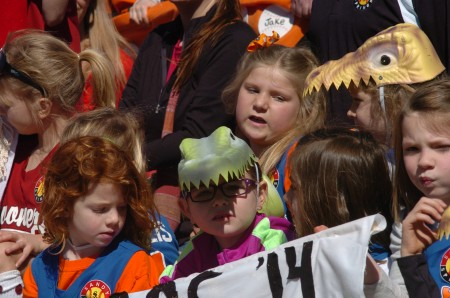 Members of the Gators ready to take the field at Morgan Falls Park during the opening day ceremony for Sandy Springs Youth Sports on March 7.