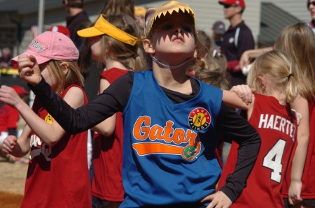 Susanna Robinson celebrates Opening Day for Sandy Springs Youth Sports at Morgan Falls Park on March 8.