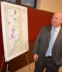 Chad Boles, president of the Briarwood Park Conservancy, checks out a map showing the city's parks and other areas for which  the city now is developing long-range plans.