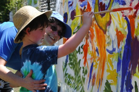 "Brook Run Park, Saturday April 26, 2014 2:00pm. Lemonade Days Festival. Sandy Springs residents, Nancy Lesser, and her son Sammy Lesser (4yr) enjoy painting on the ""Community Canvas""."