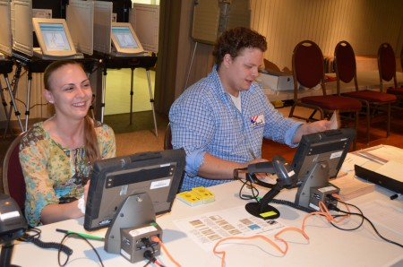 Assistant poll managers Tiffany Ray, left, and Robert Harvey check voter credentials during the May 20 primary and special election in Brookhaven.