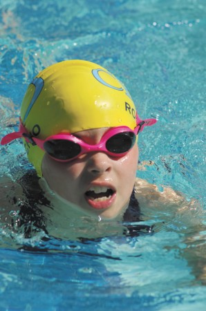 """Lila Rochio, 7, a member of the """"Tidal Waves"""" swim team at Chastain Park pool, gets in some practice before a meet with the Gainsborough """"Sting Rays"""" on June 3."""
