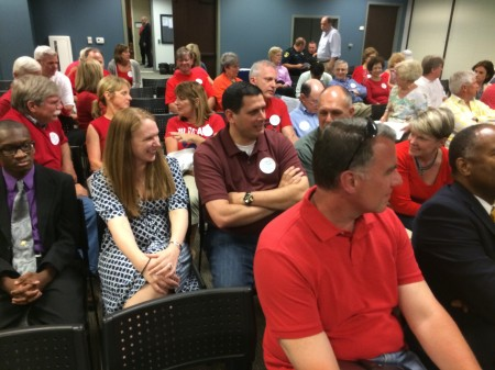 Dunwoody residents wore red shirts or stickers to show support for homeowners on Manget Way appealing a city staff member's conclusion that a house on the street could be used for a treatment home for teenage girls with eating disorders.