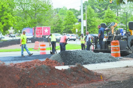 Winter weather as well as moving a deeper-than-expected water main contributed to the delay.