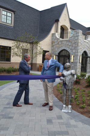 Arthur Blank,left, chats with Pace Academy Head of School Fred Assaf before cutting the ribbon to the new Blank Family Upper School at Pace. The ribbon is tied to a suit of armor, representing the school's mascot, the Knight.
