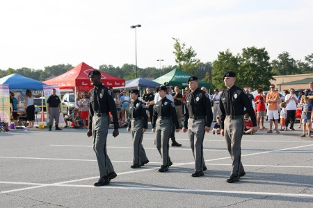Lt. Jalil Allah, 16, leads the Dunwoody Explorers in a demonstration at the 2014 Dunwoody National Night Out event hosted by the Walmart on Ashford Dunwoody Road in Dunwoody Aug. 5.